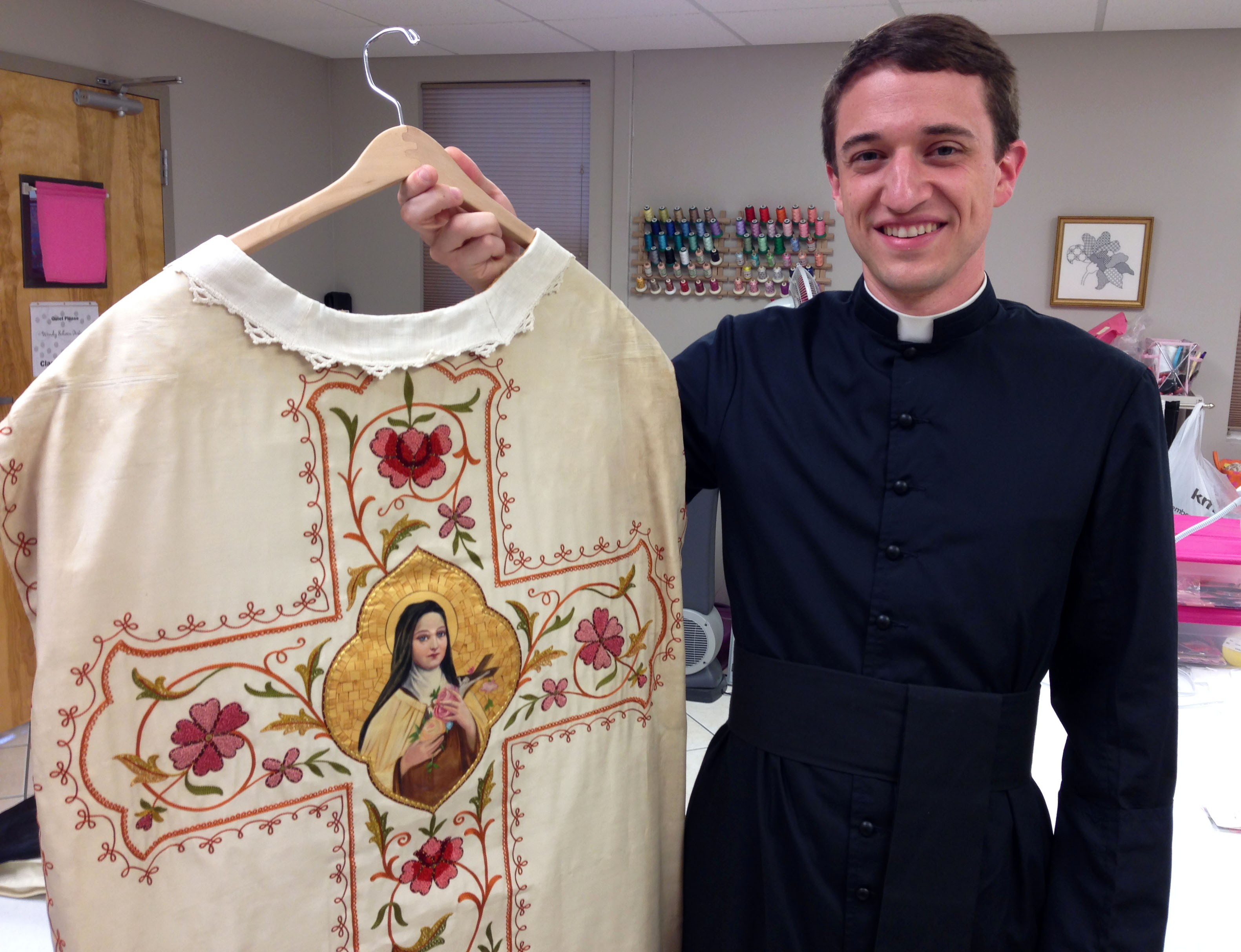 Fr. Garett O'Brien with his antique hand embroidered vestment with thread painting an goldwork.
