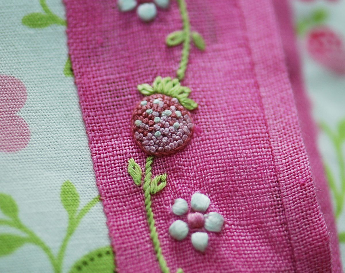A very tight closeup of the stitched berry.