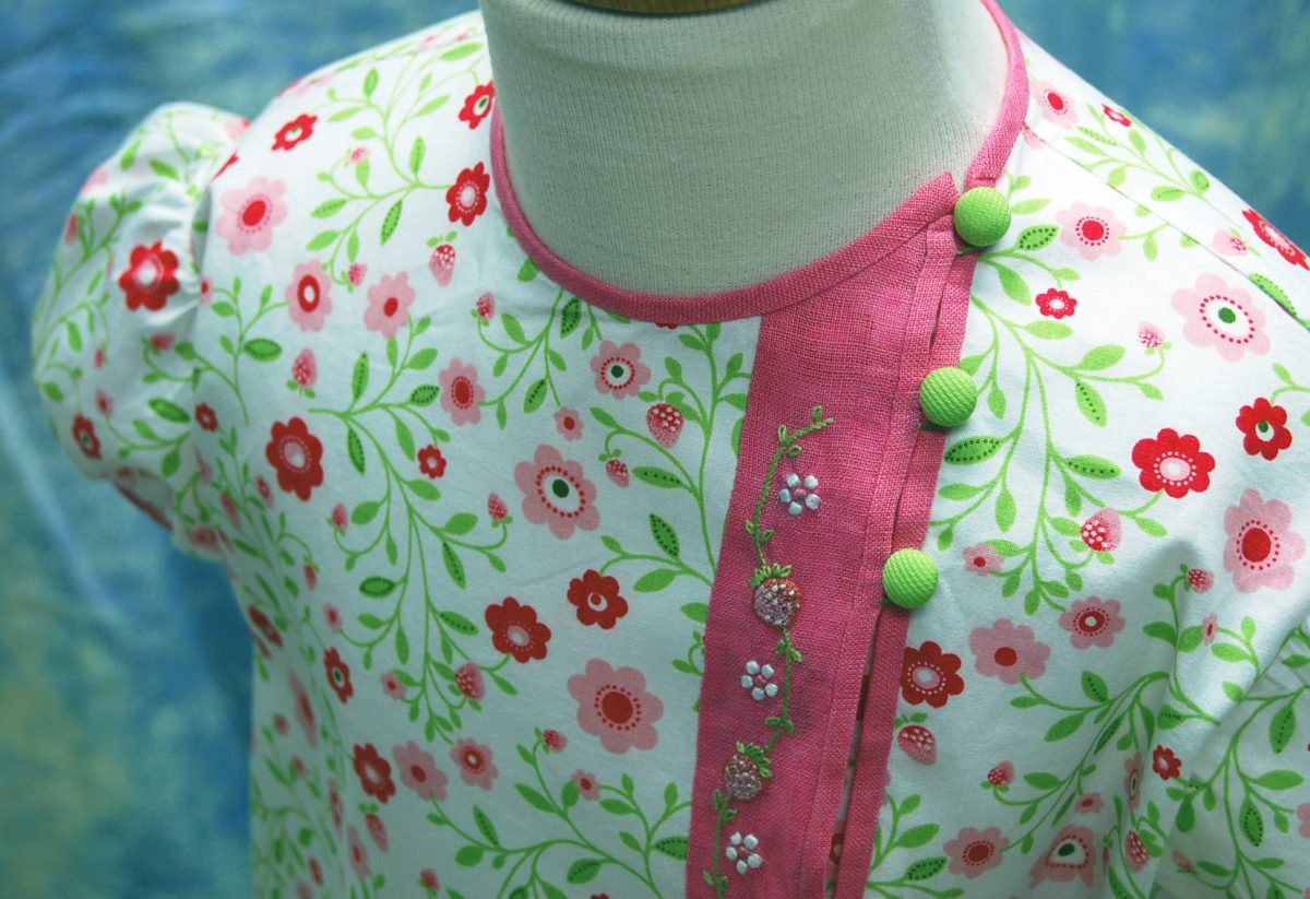 Shoulder detail showing actual size ratio of embroidery to garment.